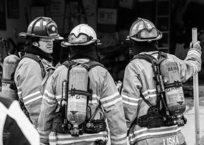 black and white photo of firemen