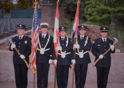 Firemen in suits with flags