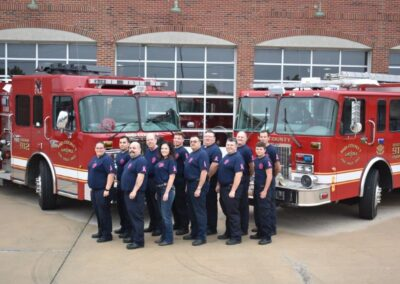 Mid County Firemen in breast cancer awareness shirts