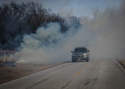 fire department driving through smoke